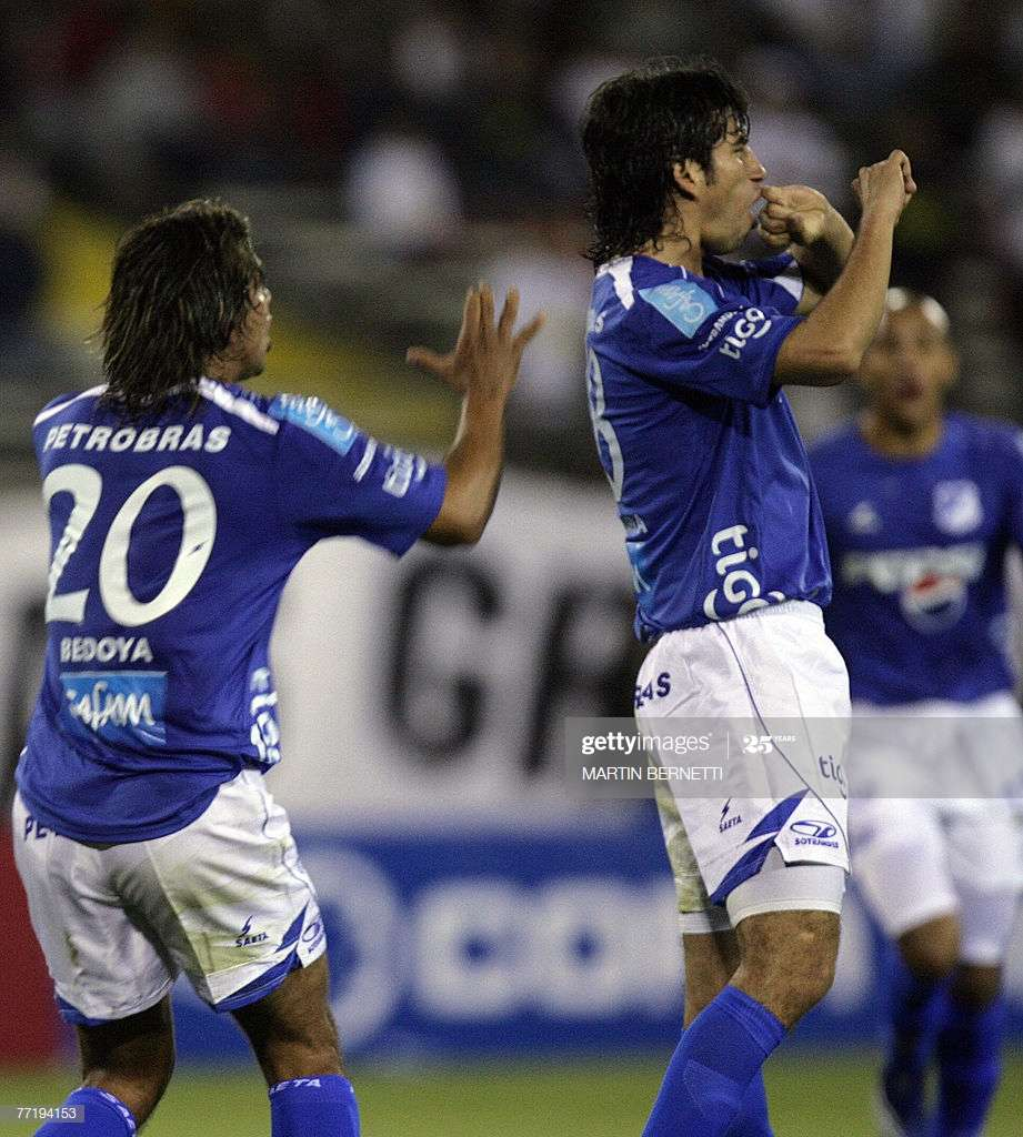 Colombian's Millonarios players Andres Mosquera (R) and Gerardo Bedoya (L) celebrate their first goal over Colo Colo during their Copa Sudamericana 04 October 2007 in Santiago, Chile.    AFP PHOTO/MARTIN BERNETTI (Photo credit should read MARTIN BERNETTI/AFP via Getty Images)